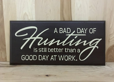 A bad day of hunting is still better than a good day at woork wood sign.