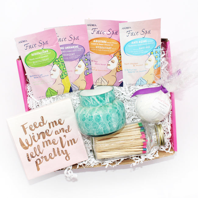 "Pamper yourself with this gift box that includes ""feed me wine and tell me I'm pretty, skeem colorful matches, volcano watercolor candle, bath bomb, face mask, etc"