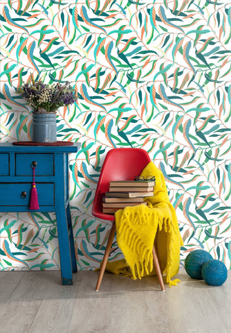 Colorful willow leaf removable wallpaper behind red chair and blue side table