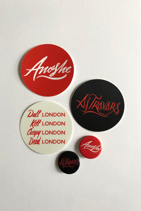 A Darker Shade of Clothing Stickers and Buttons