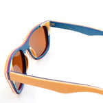 Multi Layer orange wood sunglasses made from skateboard decks. Side view of frame