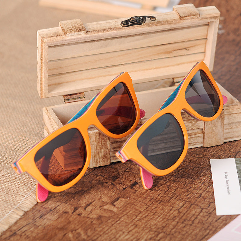 Pair of orange wood and layered skateboard wood sunglasses frame with Grey and orange lenses