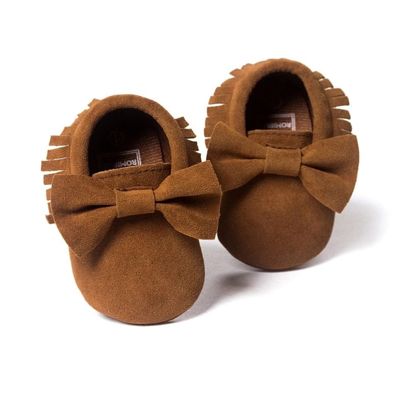Tan tassel moccasins with bow