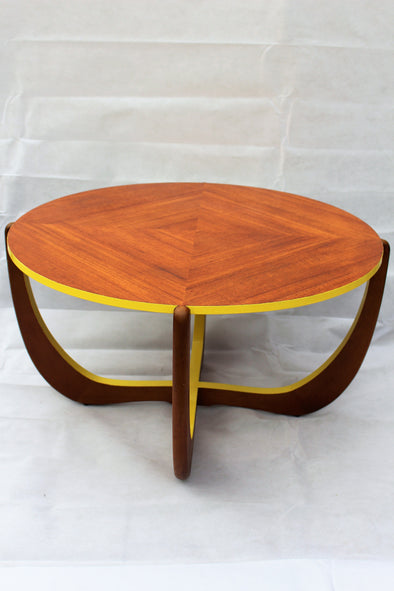 Round G Plan wood table with retro cross over legs, sides and edges have been gloss painted in bright yellow.