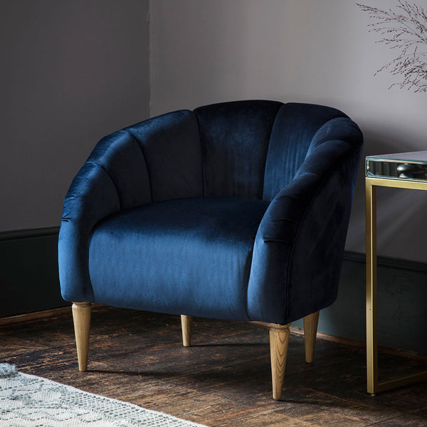 Art Deco Velvet Scallop Chair In Blue in situ in room with wooden floor and furniture