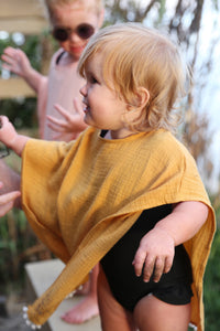 Poncho with Tassels in Mustard or Pink