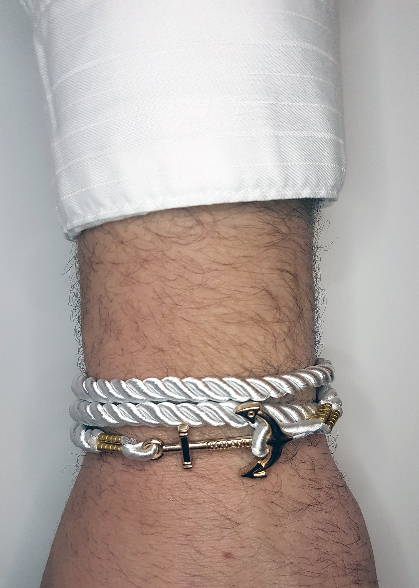 Mens white wrap around bracelet with gold anchor clip | The Perfect Gentleman