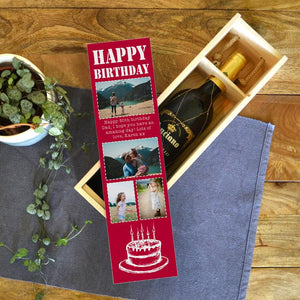 A personalised birthday wine box in red with photos and a message.