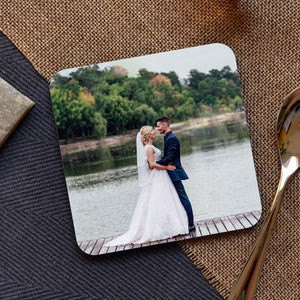 A personalised square coaster with an image of a couple getting married printed on it