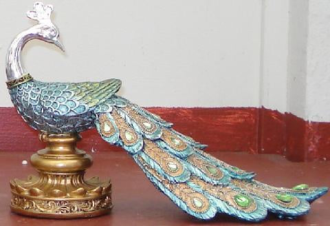Peacock on short stand