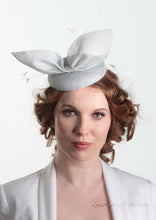 Hayley small disc Hat with bow detail in ice blue. Model front view. Hand