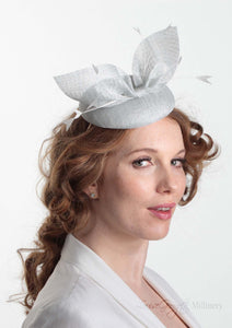 Hayley small disc Hat with bow detail in ice blue. Model side view. Hand