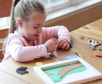 Girl playing with the Craft of Faith christian crafting bible subscription box