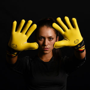 female goalkeeper wearing talon ignite goalie gloves
