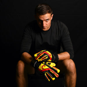 male goalkeeper wearing talon ignite keeper gloves