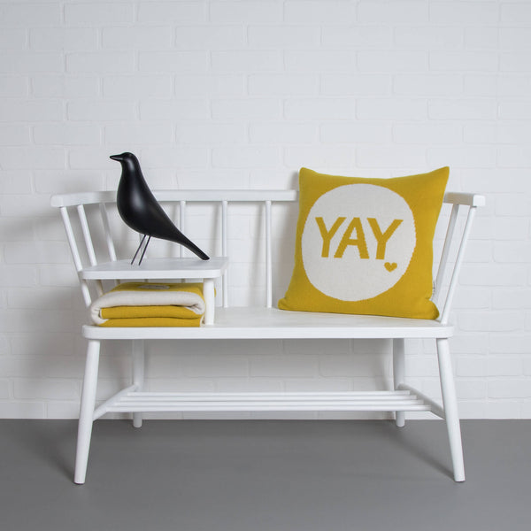 tullibee knitted cushion YAY mustard ercol bench with eames house bird