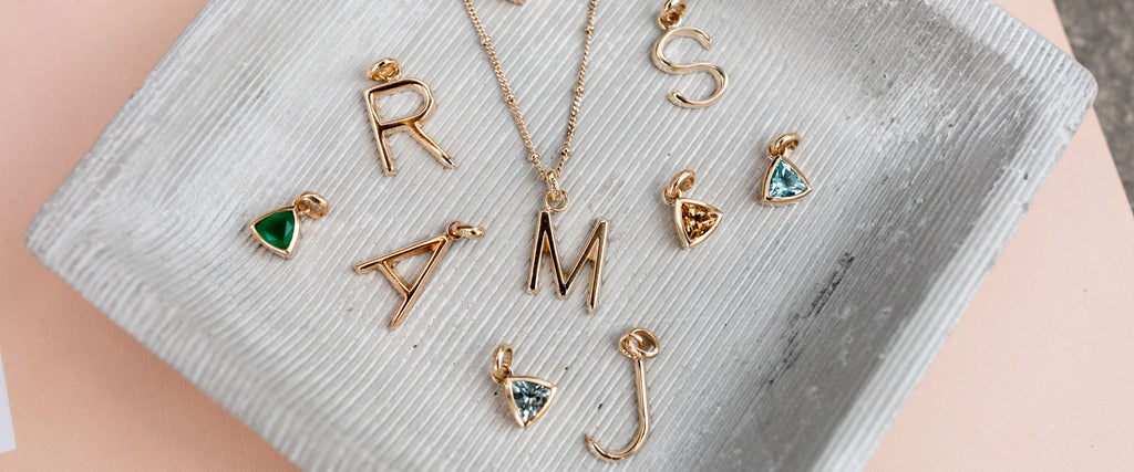 initials and gemstones