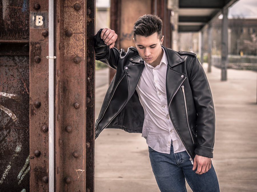 Young man wearing cheap leather