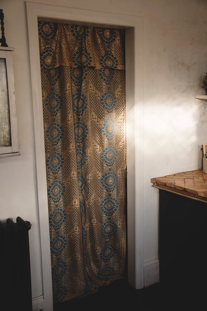 Glod and blue lace curtain. Interior styling and photography.