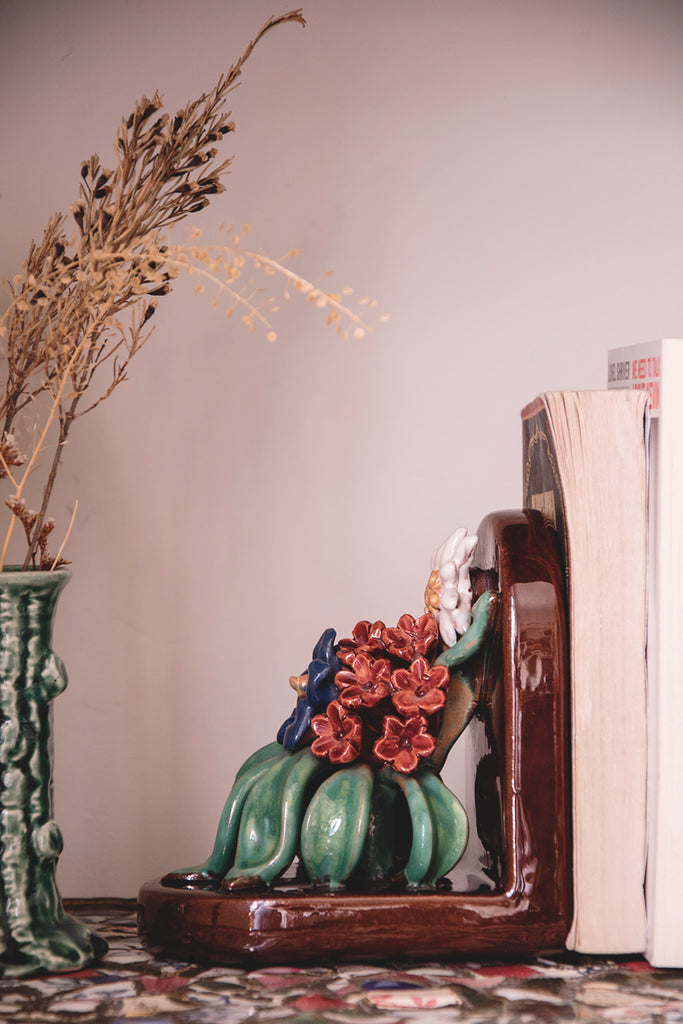 Vintage bookends on mosaic antique shelving.
