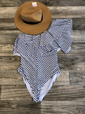One piece white and navy striped swim suit one shoulder detail.