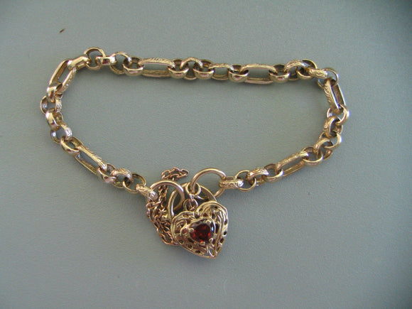 9ct Yellow Gold Bracelet With Heart Shaped Garnet Over 12.0 gms