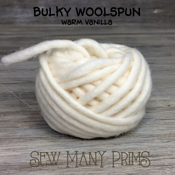 ball of off white wool yarn