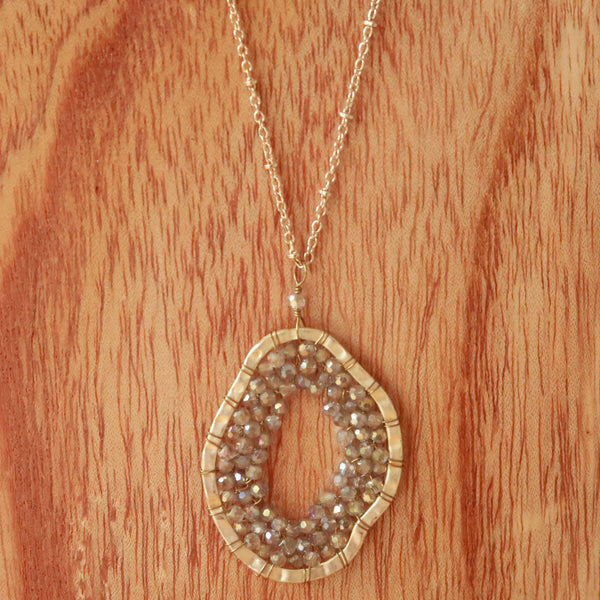 Abstract Rounded Metal and Bead Goldtone Pendant Necklace