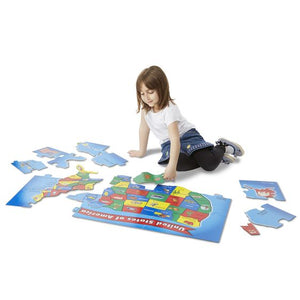 Image of child playing with 51 piece USA floor puzzle by Melissa & Doug