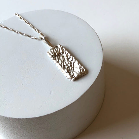 Erin Keary solid sterling silver ripple pendant on 18 inch sterling silver rolo chain.