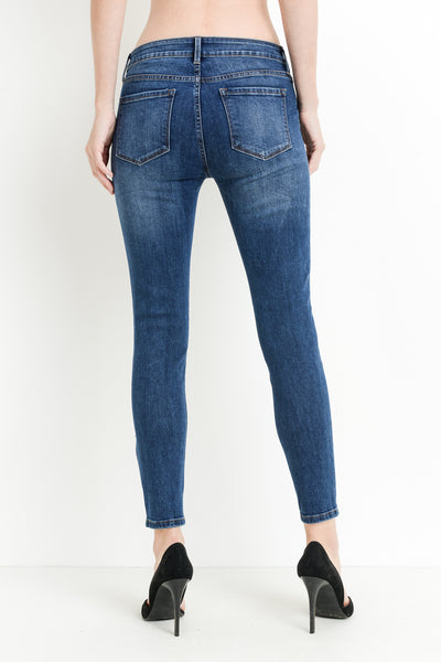Mid rise dark denim skinny jeans with distressing