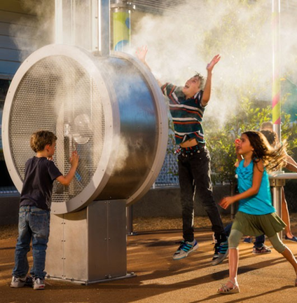 Kids enjoying a high pressure misting system by Misting Direct at a popular children's museum.