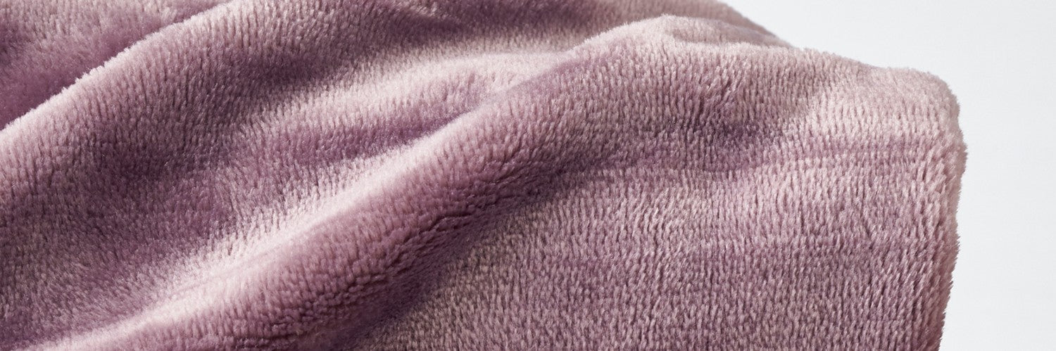 A close up of VelvetLoft solid throw in Lavender