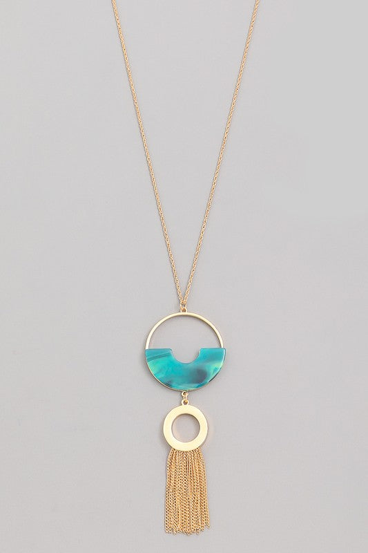 Teal half circle with gold chain tassel