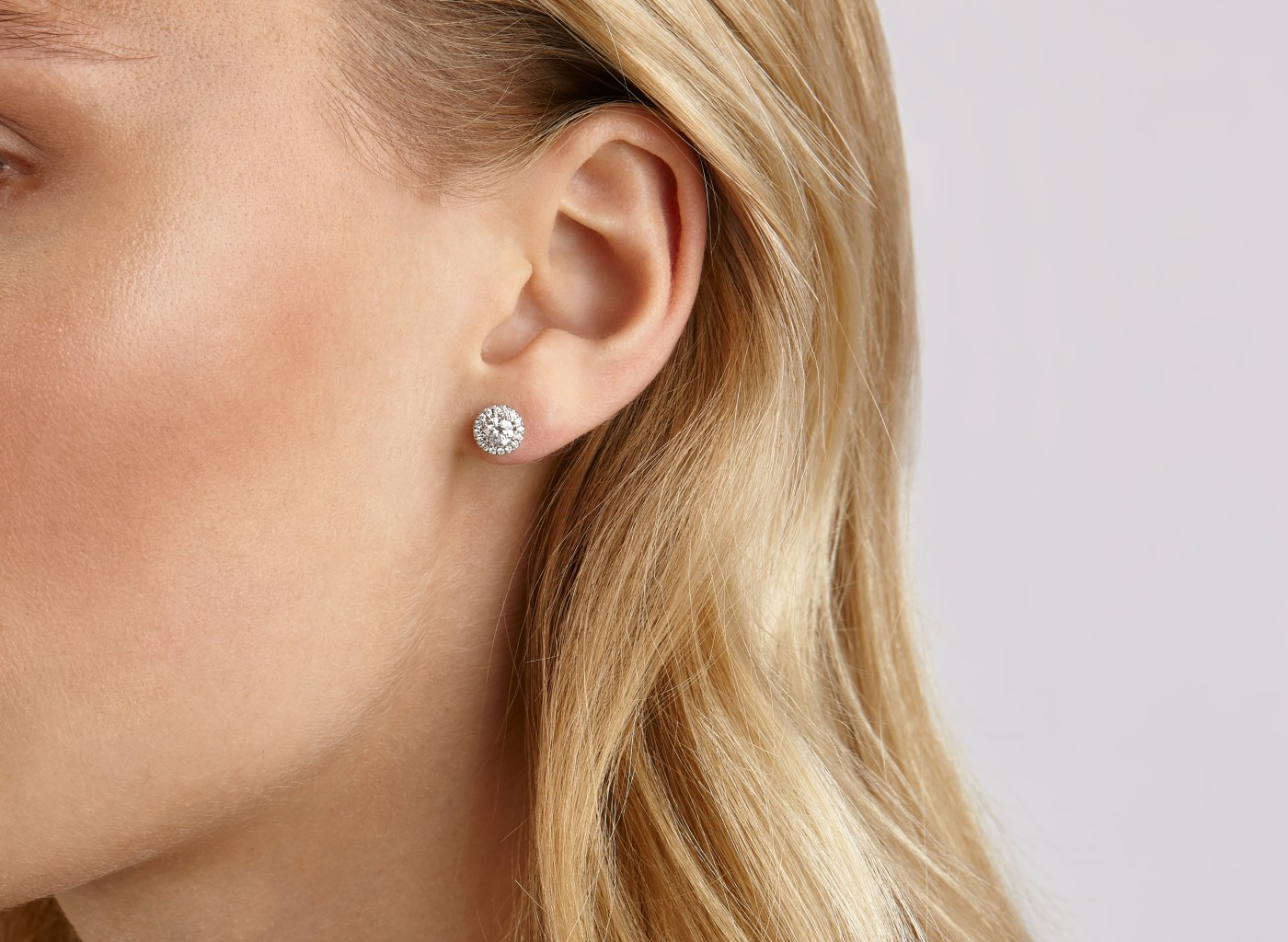 On model view Halo 1 carat earrings with white diamonds