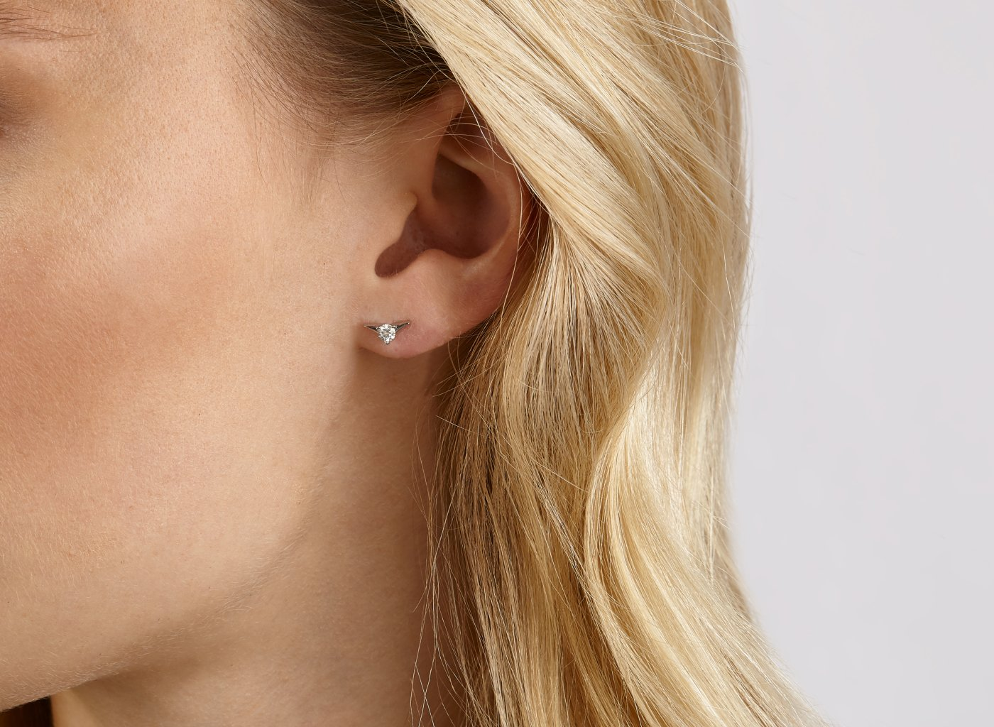 On model view of Chevron 1/8 carat earring with white diamond