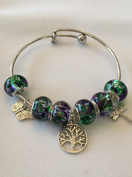 Beautiful Bangle Bracelet made with Glass Beads & Silver colored Charms
