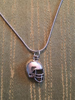 Football charm necklace Silver colored charm on silver colored snake chain