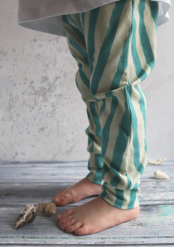 toddler legs wearing handmade stripy trousers