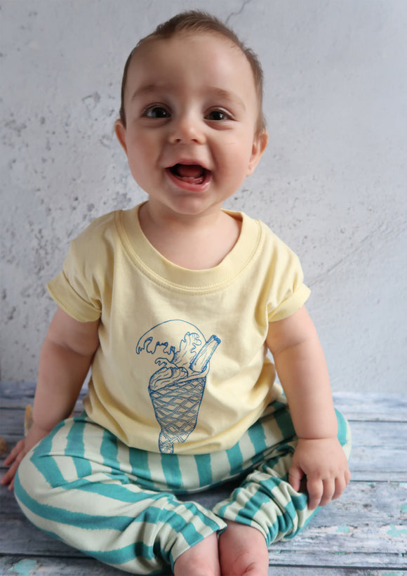 baby wearing yellow beach tshirt