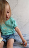 little girl in organic green tshirt