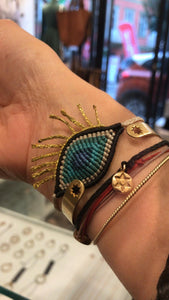 Gold eyelash eye wristband