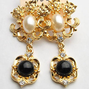 Black and gold baroque statement earrings
