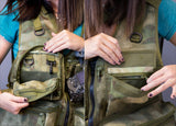 Insider pockets of custom camo photography vest