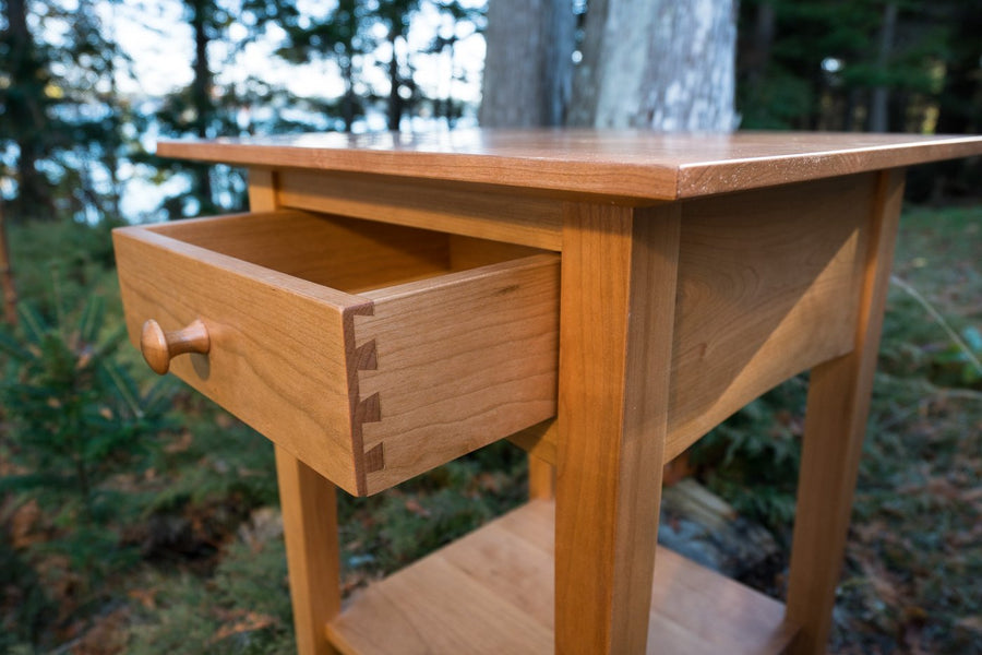 peaks point table in cherry - lifestyle image - natural wood - portland - maine - beckett street