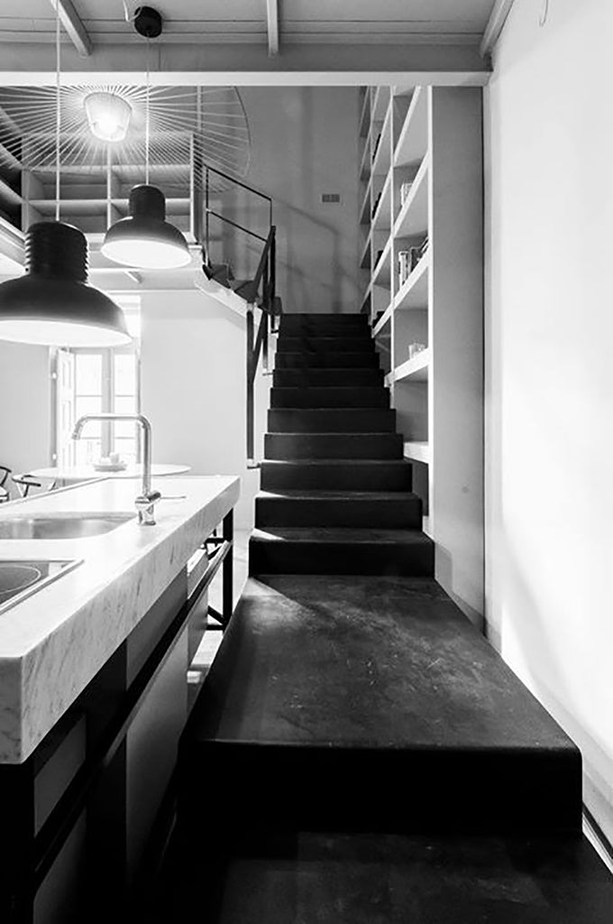 black staircase and kitchen island in bianco carrara apartment Malta