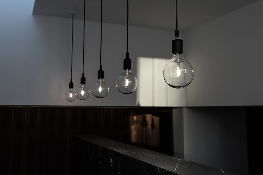 five light bulbs grey stone counter marble
