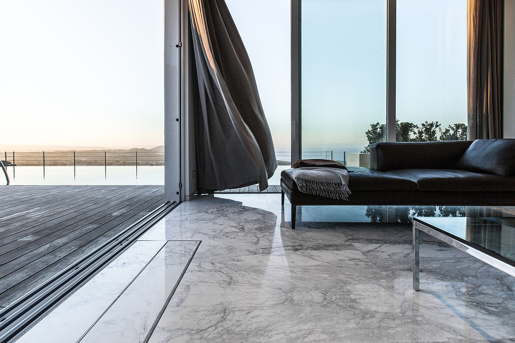 bianco statuario floor and grey stone for wall cladding living room
