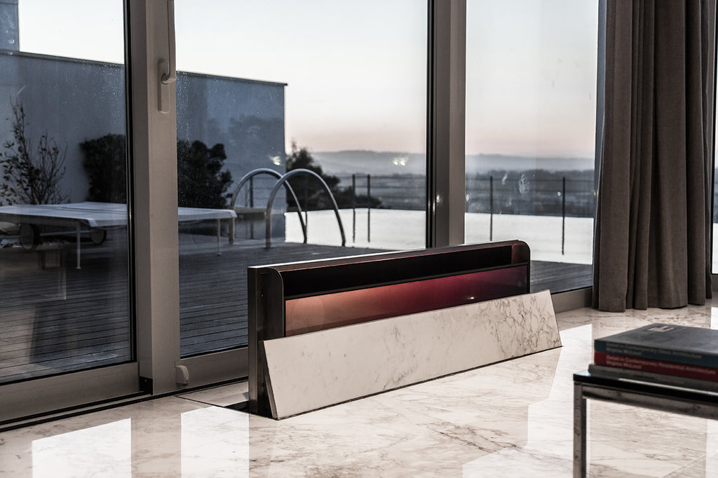 floating hidden tv from the floor in bianco statuario marble decoration