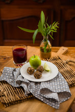 plate of energy balls, with glass of blueberry kombucha.